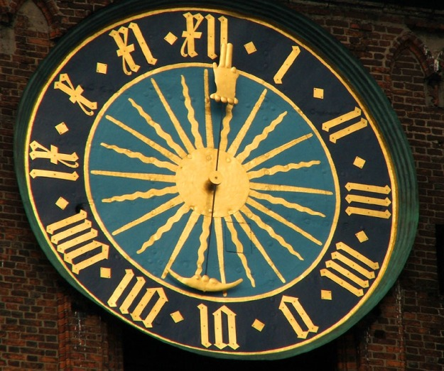 Renovated_clock_on_ss._Johns_cathedral_spire,_Toruń